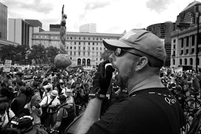 <p>A member of the group Bible Believers argues with anti-Trump demonstrators in Cleveland. (Photo: Khue Bui for Yahoo News)</p>