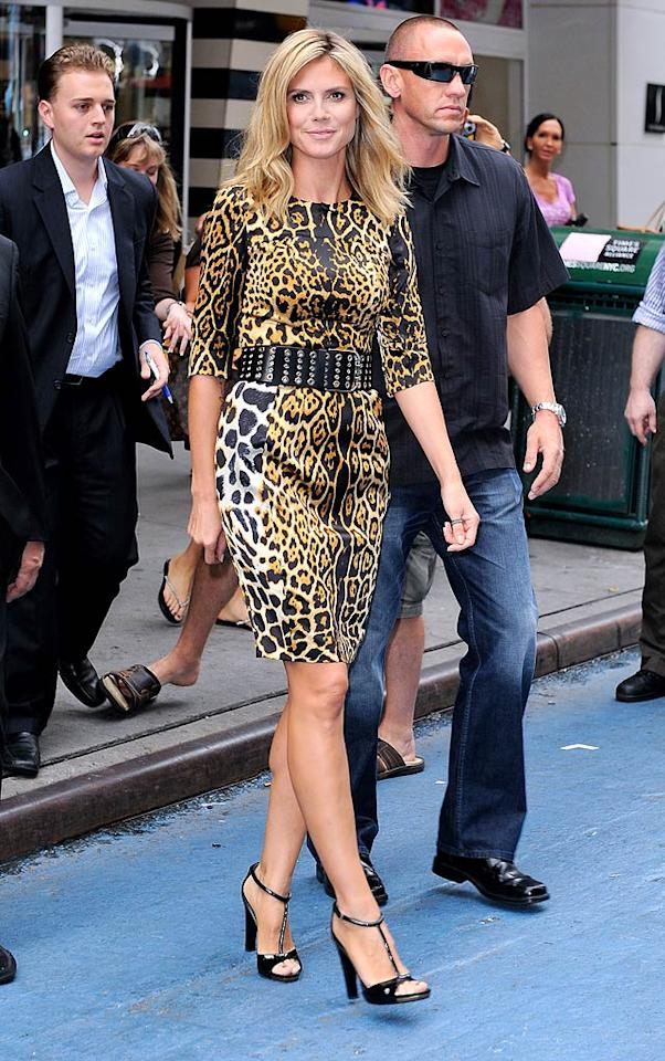 "Also looking awesome in animal print was ""Project Runway"" hostess with the mostest Heidi Klum, who stopped by ""GMA"" to promote the new season of her reality show in a $1,700 silk Yves St. Laurent frock and patent Gucci T-strap sandals. Ray Tamarra/<a href=""http://www.gettyimages.com/"" target=""new"">GettyImages.com</a> - July 25, 2011"