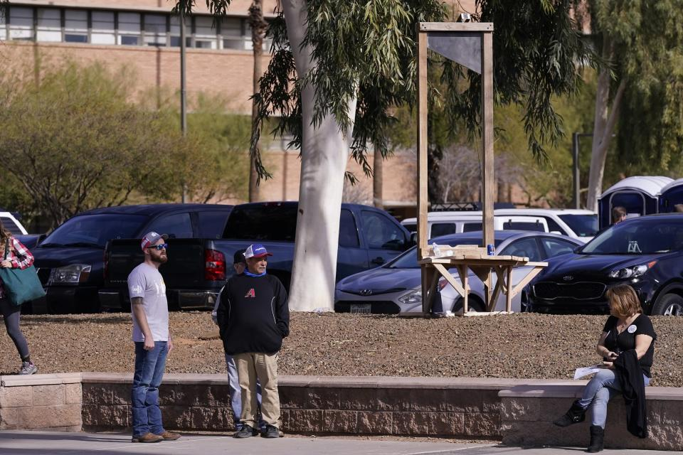 A makeshift guillotine is set up near the Arizona Capitol as supporters of President Donald Trump gather to protest at the Arizona Capitol, Wednesday, Jan. 6, 2021, in Phoenix. (AP Photo/Ross D. Franklin)