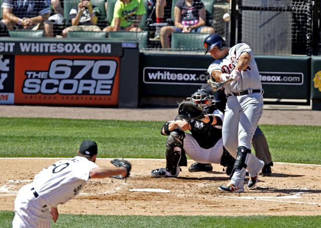 Detroit Tigers' Miguel Cabrera hits a three-run home run off Chicago White Sox starting pitcher John Danks, left, also scoring Austin Jackson and Bryan Holaday, during the third inning of a baseball game Wednesday, Aug. 14, 2013, in Chicago. The White Sox catcher is Tyler Flowers. (AP Photo/Scott Eisen)