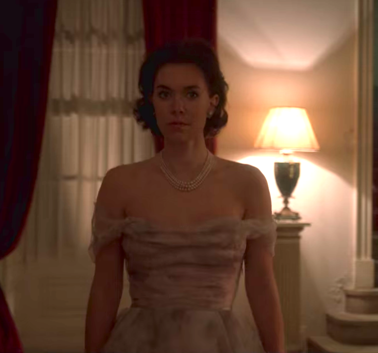 Princess Margaret wearing an off-the-shoulder knee length fit-and-flare dress