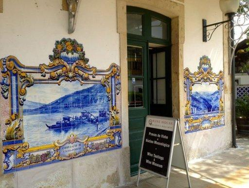 A sign advertising wine tasting is displayed outside a wine shop at the historic train station in Douro. Responding to demand, port shippers have been investing in upscale lodgings as well as restaurants, walking trails, tasting rooms, shops and museums