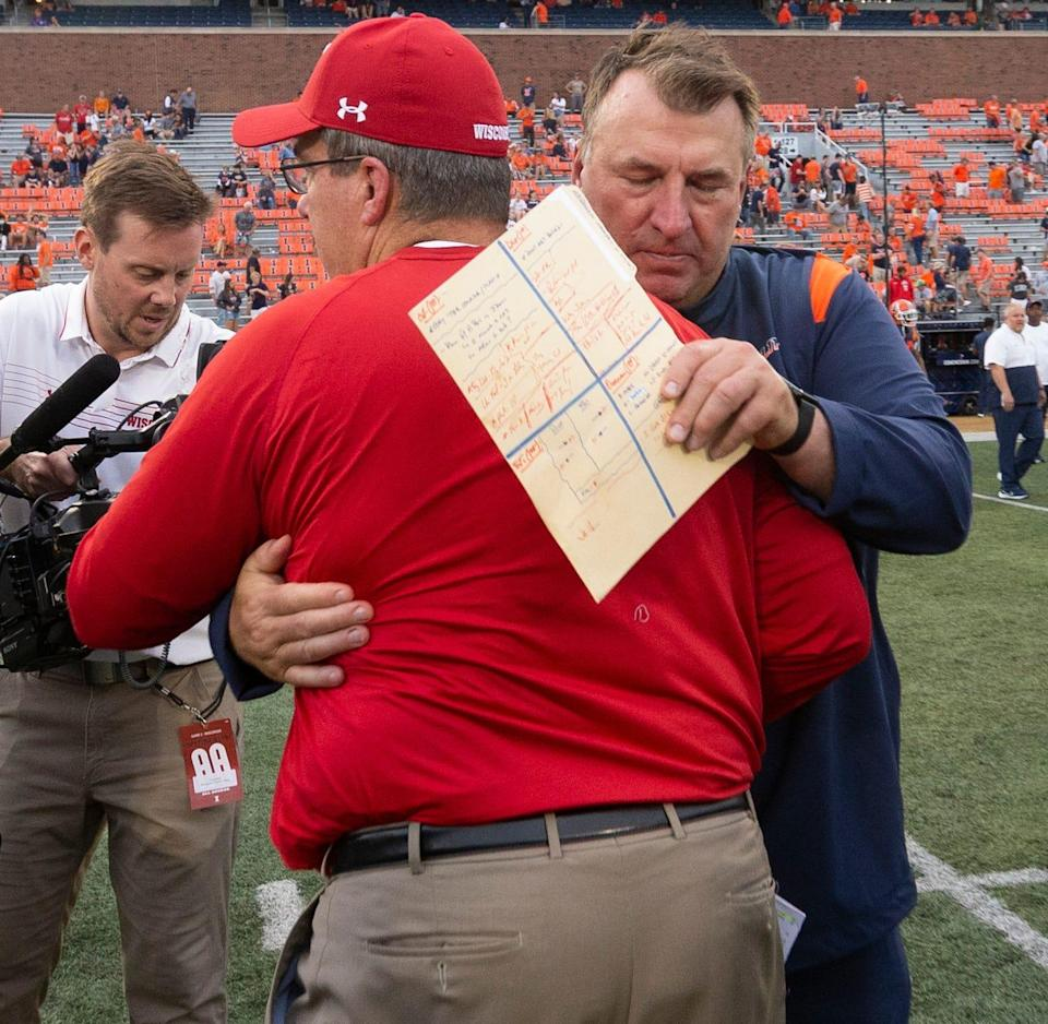 Wisconsin head football coach Paul Chryst and Illinois head coach Bret Bielema embrace after their game Saturday.
