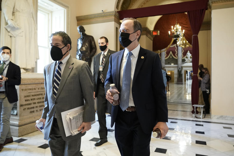 Rep. Jamie Raskin, D-Md., left, walks with Rep. Adam Schiff, D-Calif., at the Capitol in Washington, Wednesday, Jan. 13, 2021, as the House of Representatives pursues an article of impeachment against President Donald Trump for his role in inciting an angry mob to storm the Capitol last week. (AP Photo/J. Scott Applewhite)