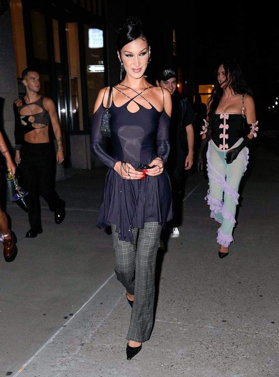 """<p>Model Bella Hadid is in New York ahead of fashion week shows and on September 8, she is rumoured to have hosted a party to celebrate the launch of her new non-alcoholic drink brand Kin Euphorics.</p><p>'There are a lot of creative people, but with creativity comes a sort of brokenness or unbalancedness. I feel that people deserve to feel good all the time…' Bella said to <a href=""""https://www.businessoffashion.com/"""" rel=""""nofollow noopener"""" target=""""_blank"""" data-ylk=""""slk:Business of Fashion"""" class=""""link rapid-noclick-resp"""">Business of Fashion</a>. 'That's why being able to come into this business and bring this back into our fashion industry is super important to me.'</p>"""