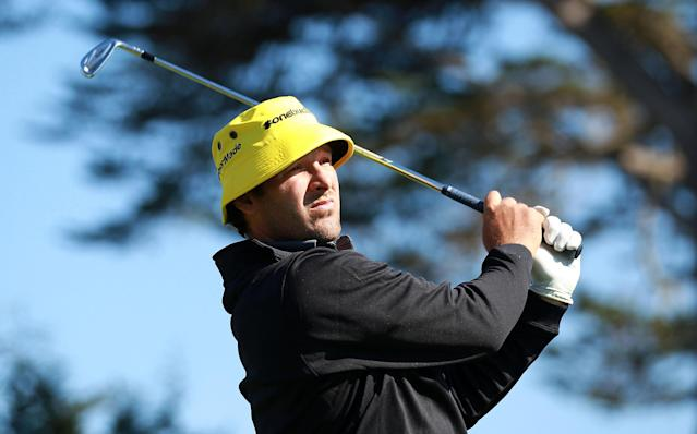PEBBLE BEACH, CA - FEBRUARY 09: Tony Romo of the Dallas Cowboys watches his tee shot on the 17th hole during the third round of the AT&T Pebble Beach National Pro-Am at Pebble Beach Golf Links on February 9, 2013 in Pebble Beach, California. (Photo by Jed Jacobsohn/Getty Images)