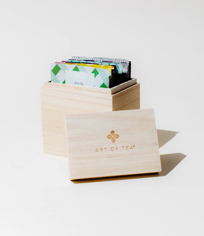 """<h2>Art Of Tea Wood Box + Sampler</h2><br>Add in this handsome pine wood box of Art of Tea's pyramid teabags filled with its most popular sampling of teas.<br><br><strong>Art Of Tea</strong> Wood Box Tea Sampler, $, available at <a href=""""https://go.skimresources.com/?id=30283X879131&url=https%3A%2F%2Fwww.artoftea.com%2Fproducts%2Fbranded-wood-box"""" rel=""""nofollow noopener"""" target=""""_blank"""" data-ylk=""""slk:Art Of Tea"""" class=""""link rapid-noclick-resp"""">Art Of Tea</a>"""