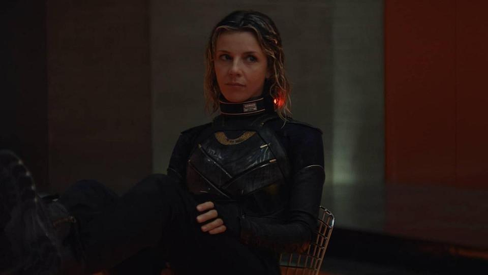 Sylvie (Sophia Di Martino), wearing a power-inhibiting collar, sits in a holding cell in Loki episode 4.