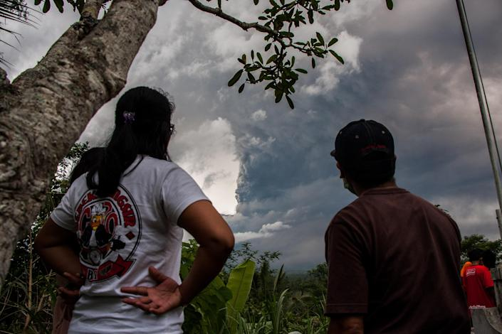 <p>Continuous eruption of volcano Agung with large volumes on Nov. 26, 2017 in Karangasem, Bali, Indonesia. Mount Agung belched smoke as high as 1,500 metres above its summit, sparking an exodus from settlements near the mountain. (Photo: Muhammad Fauzy/NurPhoto via Getty Images) </p>