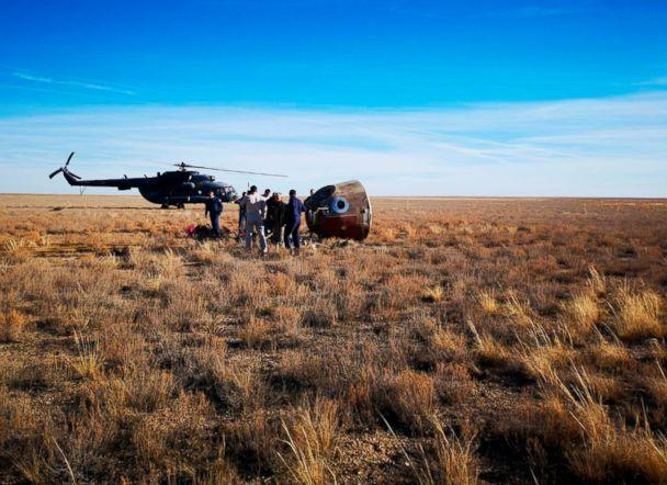 PHOTO: In this photo provided by Russian Defense Ministry Press Service, the rescue team gather next to the Soyuz MS-10 space capsule after it made an emergency landing in a field 280 miles northeast of Baikonur, Kazakhstan, Oct. 11, 2018. (Russian Defense Ministry Press Service photo via AP)