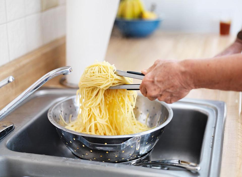 straining pasta in sink