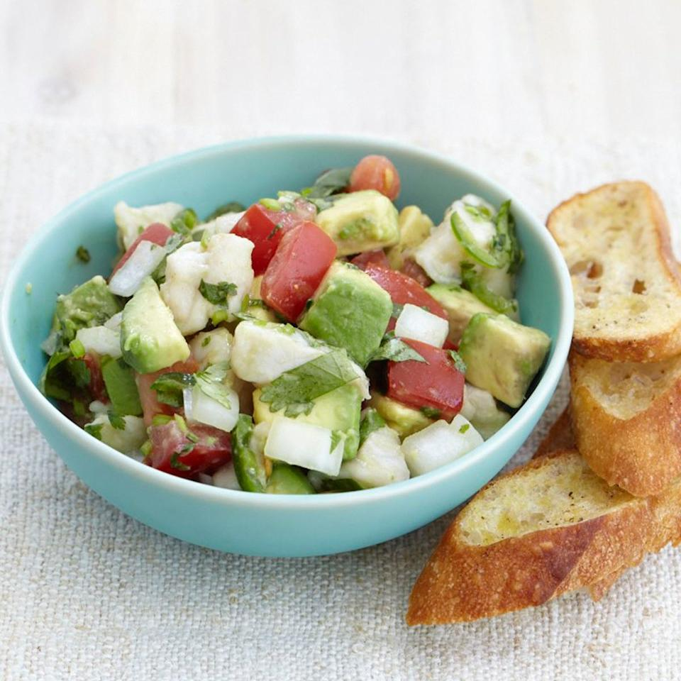 "<p>This classic ceviche recipe makes a perfect party appetizer because it's easy to prepare and can be marinated a day ahead. Celebrated chef Rick Bayless combines fish with lime and spicy chiles, then piles the mixture on tortilla chips for a no-fuss presentation. The recipe is equally delicious with snapper, halibut or other fresh fillets with mild flavor.</p><p><a href=""https://www.foodandwine.com/recipes/aspen-2002-classic-ceviche"">GO TO RECIPE</a></p>"