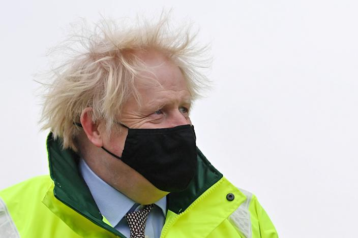 MANCHESTER, ENGLAND - JANUARY 21: Prime Minister Boris Johnson visits a storm basin near the River Mersey in Didsbury on January 21, 2021 in Manchester, England. A major incident has been declared in Greater Manchester after Storm Christophe caused flooding in the area, forcing thousands of homes to be evacuated.  (Photo by Paul Ellis - WPA Pool/Getty Images)