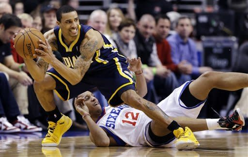 Indiana Pacers' George Hill, left, grabs a loose ball from Philadelphia 76ers' Evan Turner during the first half of an NBA basketball game, Wednesday, Feb. 6, 2013, in Philadelphia. (AP Photo/Matt Slocum)
