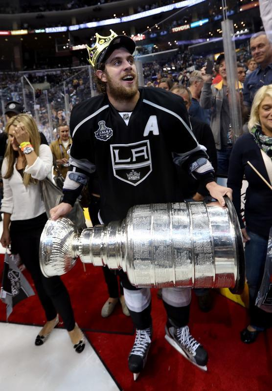 LOS ANGELES, CA - JUNE 11: Anze Kopitar #11 of the Los Angeles Kings holds the Stanley Cup after the Kings defeated the New Jersey Devils 6-1 to win the Stanley Cup series 4-2 in Game Six of the 2012 Stanley Cup Final at Staples Center on June 11, 2012 in Los Angeles, California. (Photo by Bruce Bennett/Getty Images)