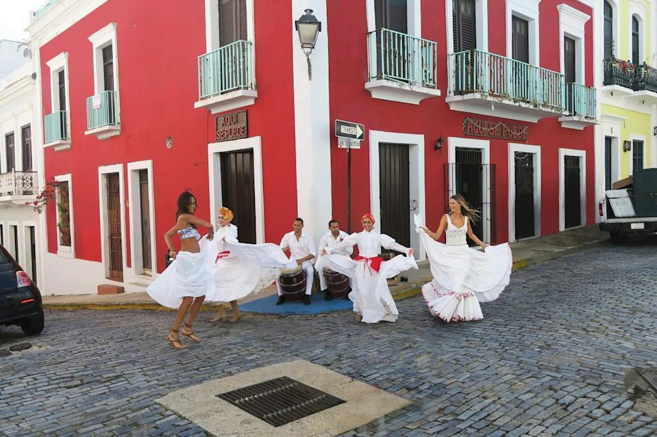 """Behati Prinsloo likes to see the culture of the location when she travels. She went to the Old Town of San Juan with Joan Smalls who was born and raised on the island and gave her a local tour in a convertible. The pair even danced together on the streets. """"Part of our culture is to be vibrant and have fun and whatever we stumble upon is full of nice surprises."""" Smalls said. """"To show her one of the traditional dances of Puerto Rico is actually really special,"""" Smalls said. She even admitted that Behati is a really good dancer was able to keep up with the experts!"""