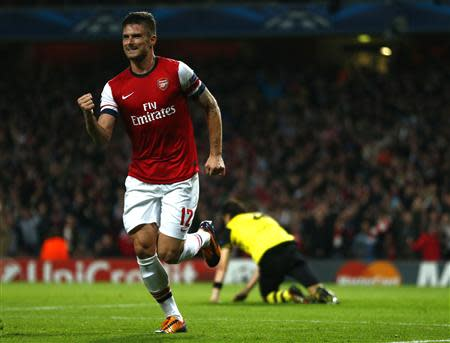 Arsenal's Olivier Giroud celebrates after scoring a goal against Borussia Dortmund during their Champions League soccer match at the Emirates stadium in London October 22, 2013. REUTERS/Eddie Keogh
