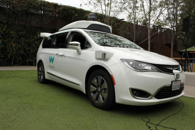 A Waymo self-driving car pulls into a parking lot at the Google-owned company's headquarters in Mountain View, California, in May 2019
