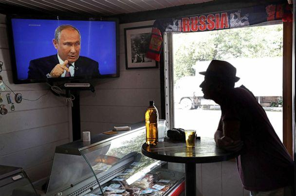 PHOTO: A bar patron watches on Russian President Vladimir Putin during a annual live broadcast call-in program outside Moscow, June 20, 2019. (Maxim Shipenkov/EPA via Shutterstock)