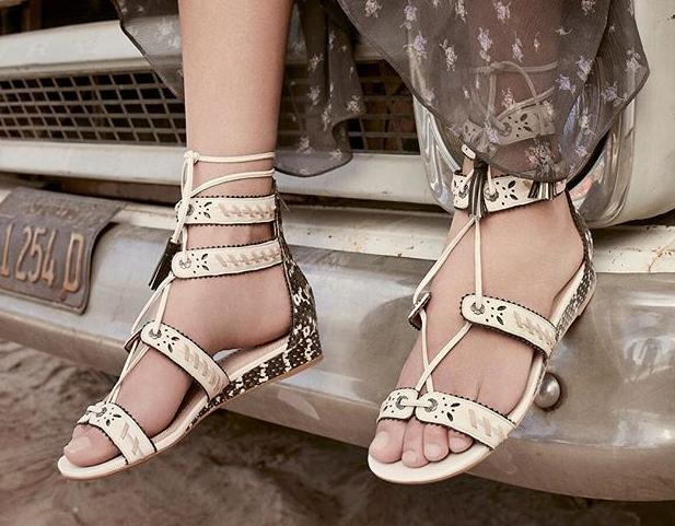 Score deeply discounted sandals, sneakers and more during Coach's huge summer sale. (Photo: Courtesy of Coach)