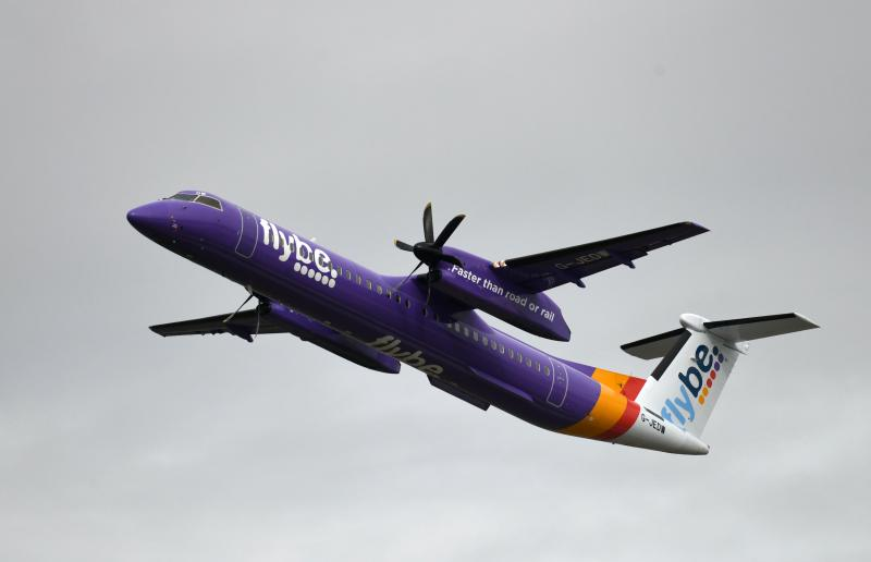 This picture shows a Dash 8 Q400 of Flybe airline during take-off on September 24, 2019 at the airport in Duesseldorf, western Germany. (Photo by INA FASSBENDER / AFP) (Photo by INA FASSBENDER/AFP via Getty Images)