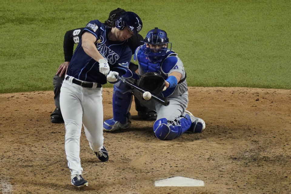 Tampa Bay Rays' Brett Phillips (14) gets the game winning hit against the Los Angeles Dodgers in Game 4 of the baseball World Series Saturday, Oct. 24, 2020, in Arlington, Texas. Rays defeated the Dodgers 8-7 to tie the series 2-2 games. (AP Photo/Sue Ogrocki)
