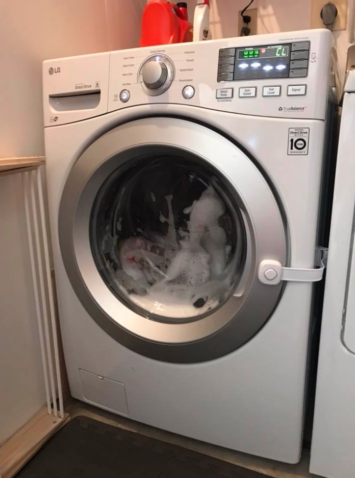 McIver's three-year-old daughter became locked inside her front-loading washing machine as it was filling up with water. Image via Lindsey McIver/Facebook.