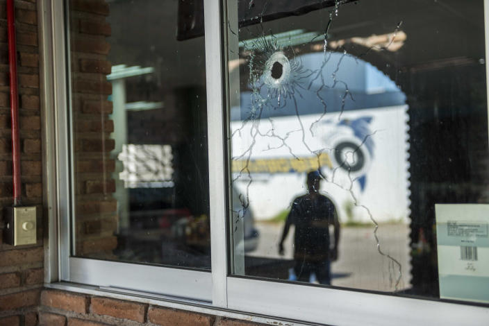 """A bullet hole fragments the window of a building, from a recent shootout in Culiacan, Mexico, Saturday, Oct. 26, 2019. The physical scars of the Oct. 17 gunbattles _ what's come to be known as """"black Thursday"""" by residents of Culiacan, the capital of Sinaloa and a stronghold of the Sinaloa cartel long led by Joaquín """"El Chapo"""" Guzmán _ are beginning to heal, but residents are still coming to grips with the worst cartel violence in recent memory. (AP Photo/Augusto Zurita)"""