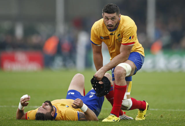 Rugby Union - Italy v Romania - IRB Rugby World Cup 2015 Pool D - Sandy Park, Exeter, England - 11/10/15 Romania's Valentin Poparlan and Florin Vlaicu look dejected at the end of the match Action Images via Reuters / Andrew Couldridge Livepic