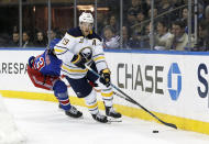FILE - In this Friday, Feb. 7, 2020, file photo, Buffalo Sabres defenseman Jake McCabe controls the puck during the second period of an NHL hockey game against the New York Rangers in New York. For the teams that missed the 2020 playoffs, they've spent the past 10 months waiting for the compressed 56-game 2021 season. (AP Photo/Jim McIsaac, File)