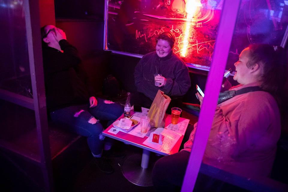 <p>Members of the public who have ordered McDonalds at the G-A-Y bar in Soho, London</p> (PA)