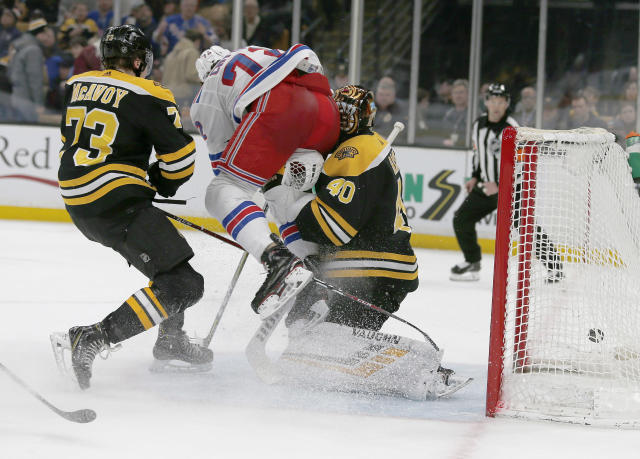 FILE - In this Jan. 19, 2019, file photo, New York Rangers center Filip Chytil (72) collides with Boston Bruins goaltender Tuukka Rask (40) as he scores a goal during the first period of an NHL hockey game in Boston. The goal counted, Chytil faced no repercussions and Rask was concussed. Those kinds of collisions are happening at an alarming rate over the past couple of seasons, leading to an increase in goaltender concussions. (AP Photo/Mary Schwalm, File)