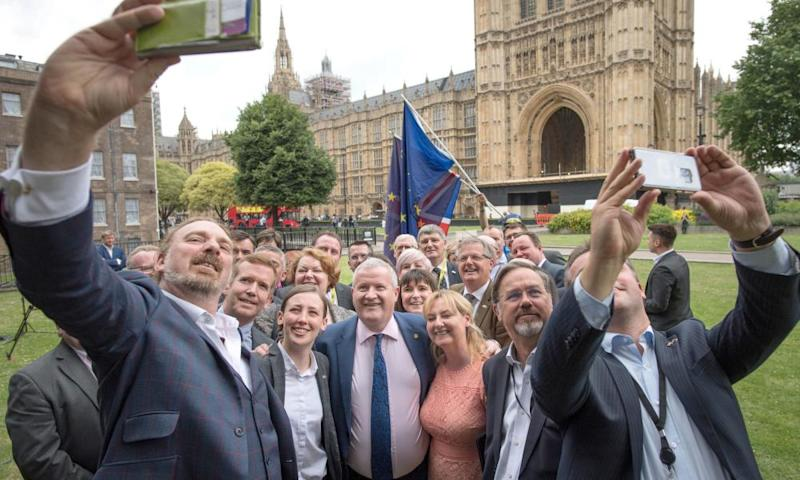 Ian Blackford, centre, the SNP's leader at Westminster, surrounded by the party's MPs, after he was asked to leave the House of Commons sittings for challenging Speaker John Bercow.