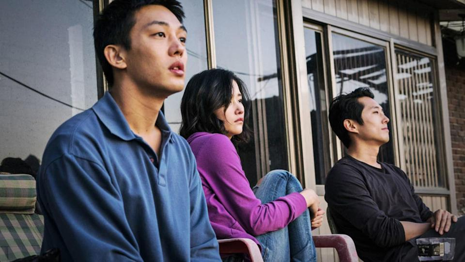 Yoo Ah-In, Jeon Jong-seo, and Steven Yeun watch a sunset from a back porch
