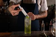 "<p><strong>Ingredients</strong></p><p>.75 oz Lemorton Calvados<br>.75 oz Fords Gin<br>.5 oz Re-Animator Transfusion*<br>2 oz Fever Tree Tonic<br>Soda<br>1 barspoon lime juice</p><p><strong>Instructions</strong></p><p>Build all ingredients (except Transfusion liqueurs) in Collins glass with ice, leaving one quarter of the glass unfilled. Fill plastic syringe half-way with ""Re-Animator Transfusion"" and have drinker infuse drink upon serving.</p><p><em>*Re-Animator Transfusion: </em>.25 oz Midori, 1 barspoon of Strega Herbal Liqueur, 1 barspoon of Combier Abricot Liqueur</p><p><em>Recipe Courtesy of Brian Evans, Bar Director of Sunday Hospitality (<a href=""http://www.sundayinbrooklyn.com/"" rel=""nofollow noopener"" target=""_blank"" data-ylk=""slk:Sunday In Brooklyn"" class=""link rapid-noclick-resp"">Sunday In Brooklyn</a>, <a href=""http://www.thirdsbk.com/"" rel=""nofollow noopener"" target=""_blank"" data-ylk=""slk:Rule Of Thirds"" class=""link rapid-noclick-resp"">Rule Of Thirds</a>)</em></p>"
