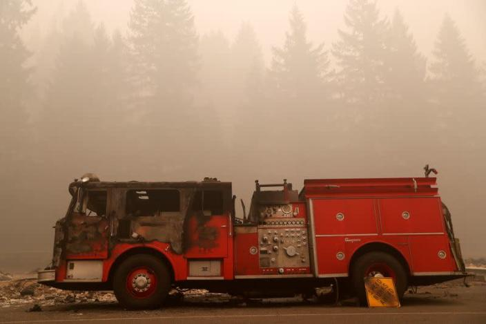 A fire damaged fire truck sits in the aftermath of the Beachie Creek fire in Detroit, Oregon