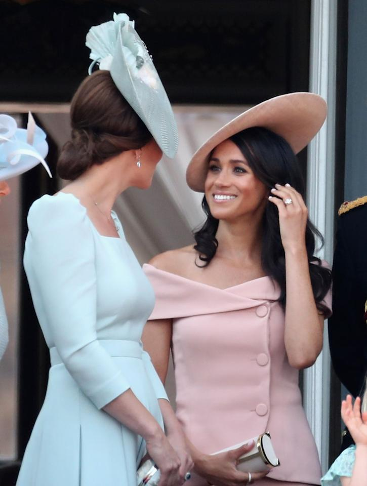"<p>Meghan wore a similar number for her first ever Trooping the Colour (the Queen's birthday celebration) on June 9, 2018. It was her second post-wedding appearance, and she accessorized the custom <a href=""https://www.cosmopolitan.com/entertainment/a21265528/meghan-markle-trooping-the-colour-exposed-shoulders-royal-protocol-backlash-criticism/"" target=""_blank"">Carolina Herrera dress</a> with a  Philip Treacy hat. </p>"