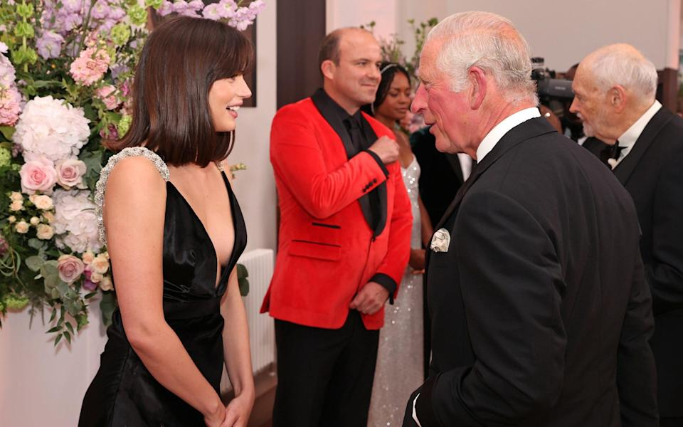 The Prince of Wales meets some of the cast including Ana de Armas at the Royal Albert Hall