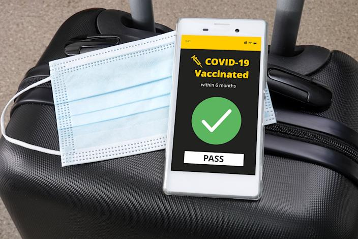 Smartphone with digital vaccination certificate for COVID-19 on a luggage.