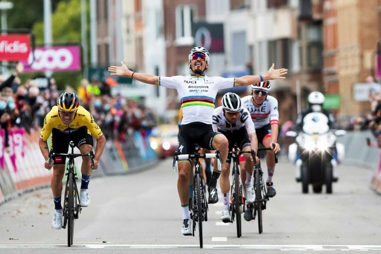 Julian Alaphilippe celebrated victory too soon at Liege-Bastogne-Liege in 2020 and was caught by Primoz Roglic (left)