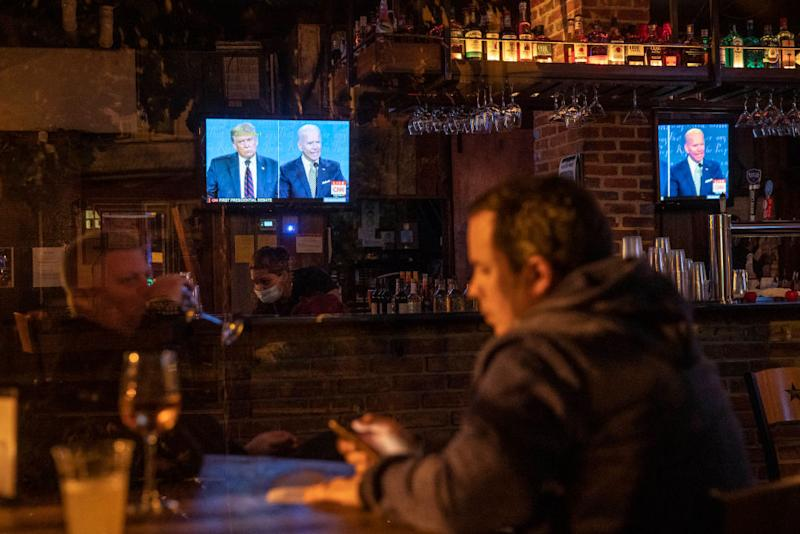 People watch the first presidential debate at a pub in Washington. Source: Getty