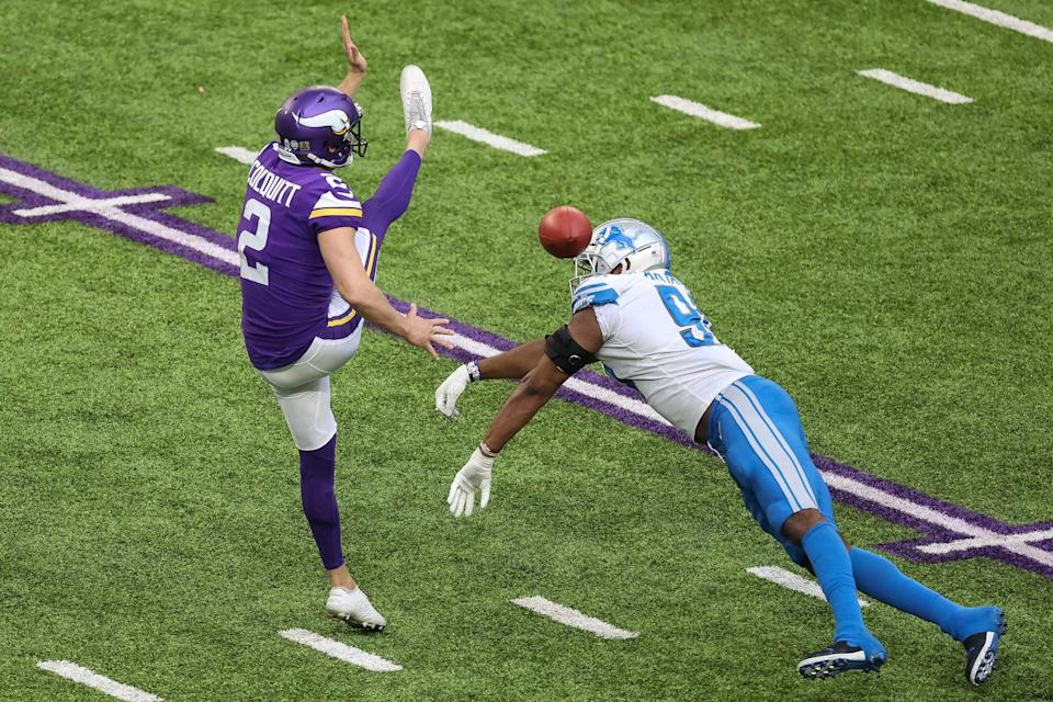 Detroit Lions defensive end Austin Bryant (94) blocks a punt by Minnesota Vikings punter Britton Colquitt (2) during the fourth quarter at U.S. Bank Stadium in Minneapolis on Nov. 8, 2020.