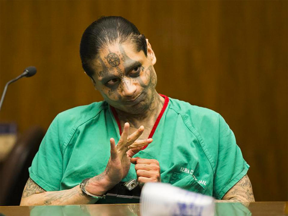 Jaime Osuna is seen during his sentencing for murder in Bakersfield, Calif., in May 2017. Shortly after the sadistic torture slaying and beheading of a convicted killer, apparently at the hands of his cellmate, Osuna, prison guards making their rounds reported that both men were alive, according to two new reports on California lockups from the state inspector's general office. The reports raise new questions about the heinous attack at Corcoran State Prison in March 2019 that has prompted investigations and a lawsuit by the family of the victim, Luis Romero, the Los Angeles Times reported Wednesday, May 26, 2021. Osuna, is accused of using a makeshift knife to decapitate and dissect Romero, removing an eye, a finger and a portion of the man's lung, state documents show. (Felix Adamo/The Bakersfield Californian via AP, File)