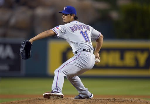 Texas Rangers starting pitcher Yu Darvish throws to the plate during the second inning of the Rangers' baseball game against the Los Angeles Angels, Thursday, Sept. 20, 2012, in Anaheim, Calif. (AP Photo/Mark J. Terrill)