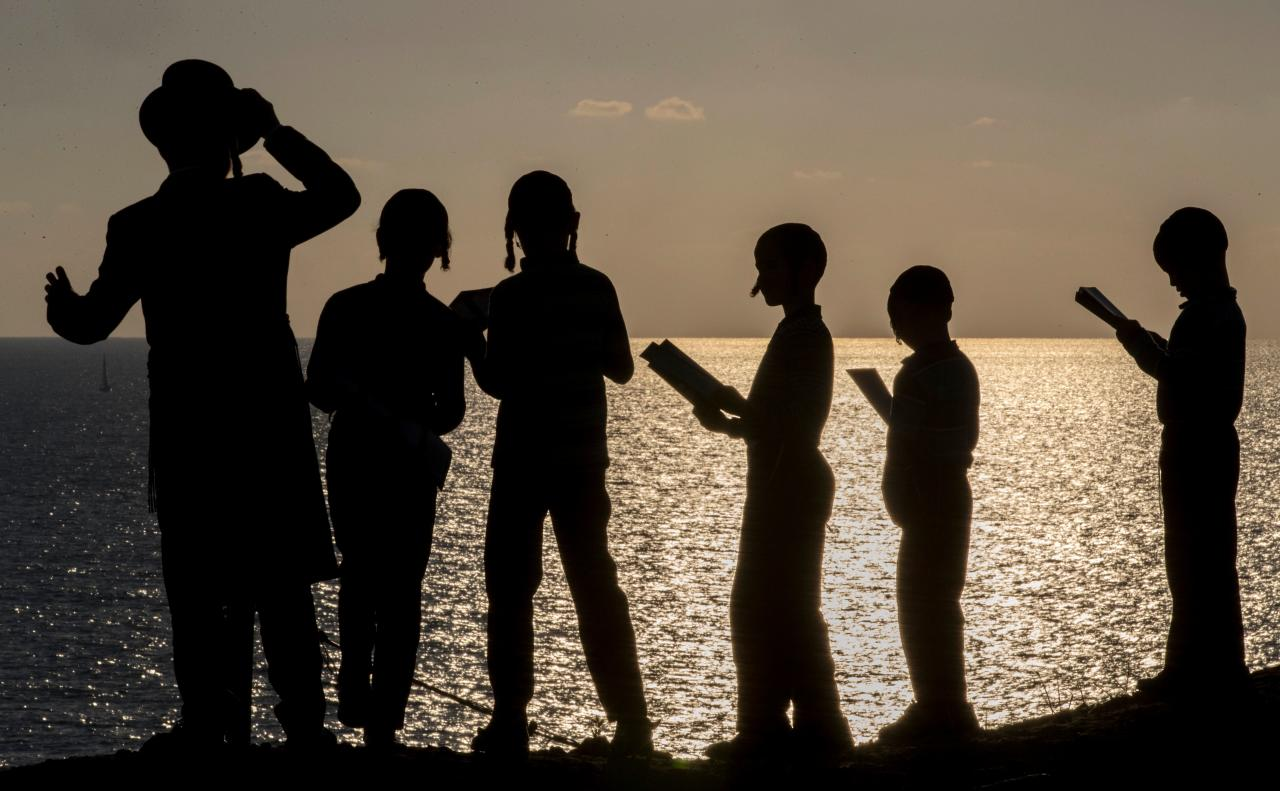 "<p>Ultra-Orthodox Jewish boys pray along the Mediterranean Sea in the Israeli city of Herzliya, near Tel Aviv, while performing the ""Tashlich"" ritual on Sept. 28, 2017, during which ""sins are cast into the water to the fish"". The ""Tashlich"" ritual is performed before the Day of Atonement, or Yom Kippur, the most important day in the Jewish calendar, which in 2017 starts at sunset on Sept. 29. (Photo: Jack Guez/AFP/Getty Images) </p>"