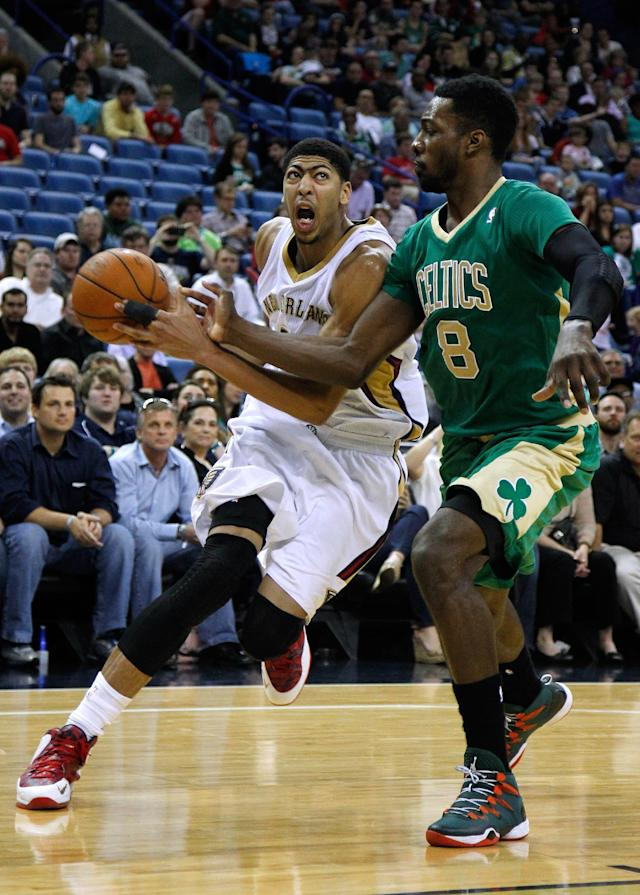 New Orleans Pelicans forward Anthony Davis, left, drives against Boston Celtics forward Jeff Green (8) during the second half of an NBA basketball game in New Orleans, Sunday, March 16, 2014. The New Orleans Pelicans won 121-120. (AP Photo/Jonathan Bachman)