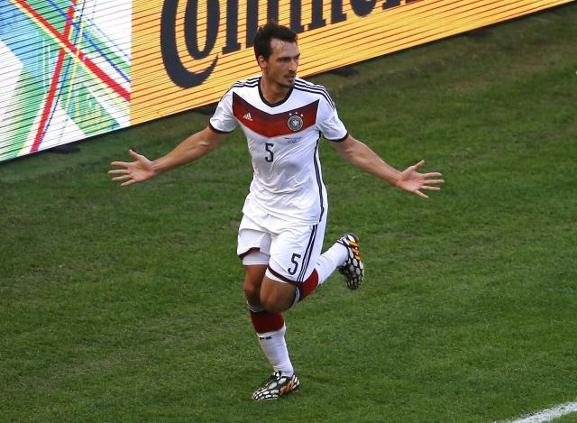 Germany's Mats Hummels celebrates after scoring a goal during the 2014 World Cup quarter-finals between France and Germany at the Maracana stadium in Rio de Janeiro July 4, 2014. REUTERS/Ricardo Moraes (BRAZIL - Tags: SOCCER SPORT WORLD CUP)