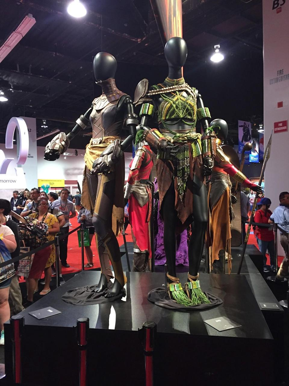 <p>Shuri (Letitia Wright) is the sister of T'Challa. Ayo (Florence Kasumba), whom we briefly met in <em>Captain America: Civil War</em>, is the king's security chief. (Photo: Marcus Errico/Yahoo Movies) </p>
