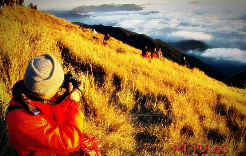 At the summit of Mt. Pulag. (Photo courtesy of Tin Fuentebella)