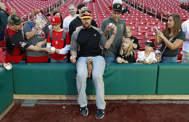 Pittsburgh Pirates catcher John Buck signs autographs before Game 5 of a National League baseball division series between the Pirates and the St. Louis Cardinals on Wednesday, Oct. 9, 2013, in St. Louis. (AP Photo/Jeff Roberson)